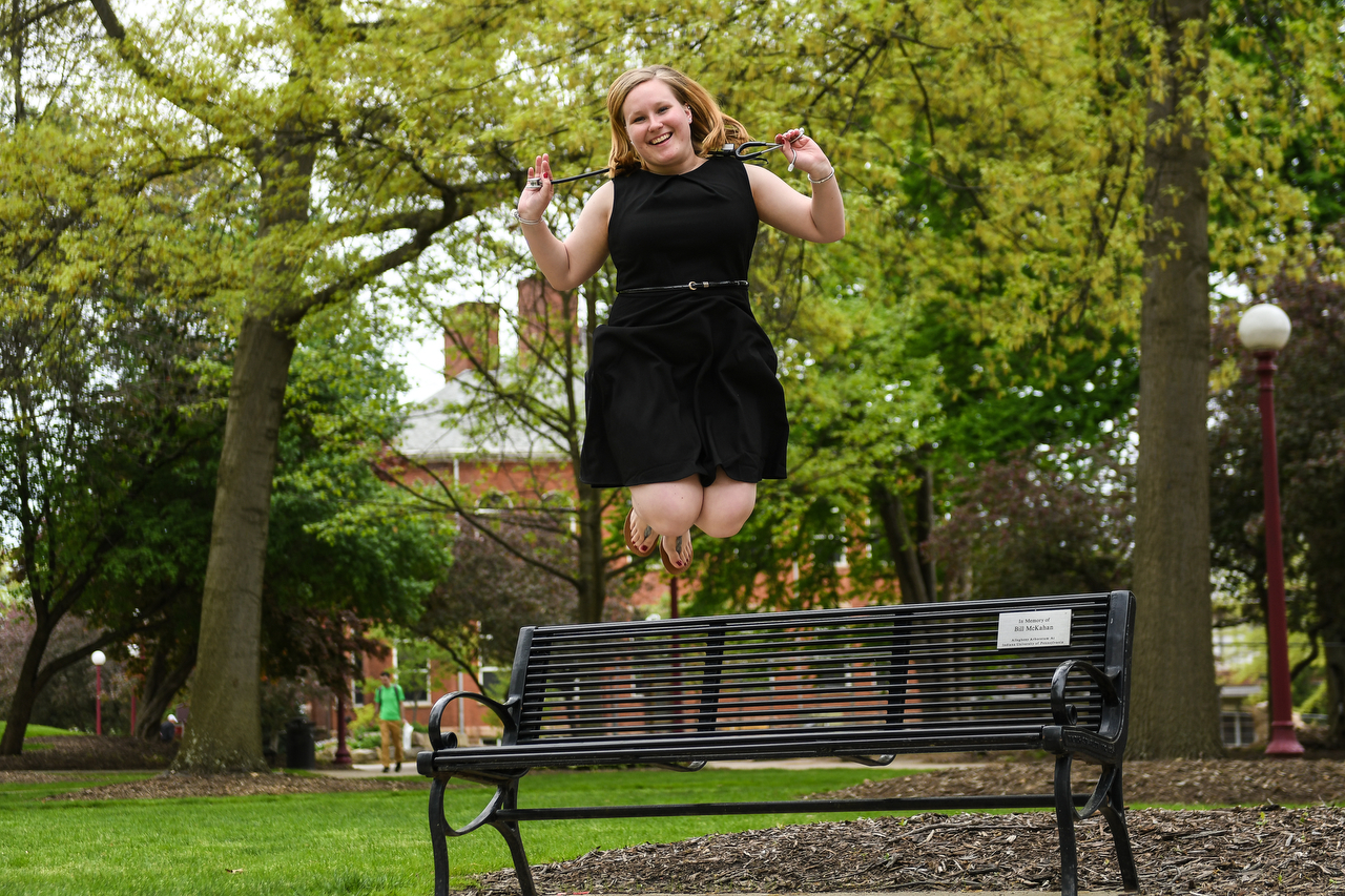 Nursing student jumping in the air